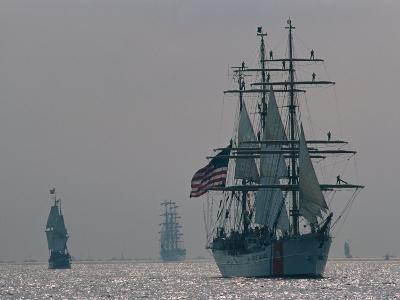 The United States Coast Guard Ship Eagle with Several Other Sailing Ships