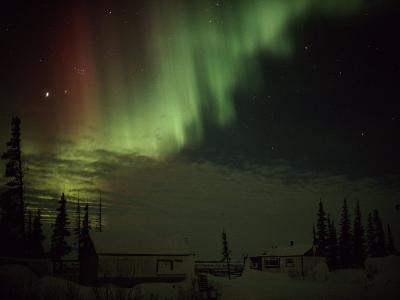 The Aurora Borealis Streaks Down Across the Night Sky