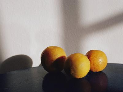 Still Life of Three Oranges on a Table