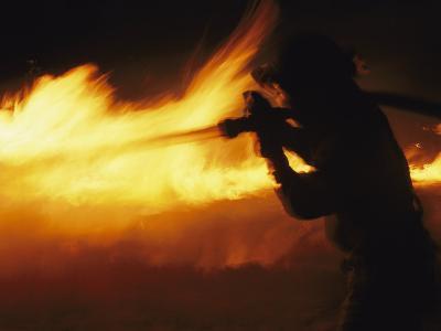 Fire-Fighter Battling a Blaze at Night