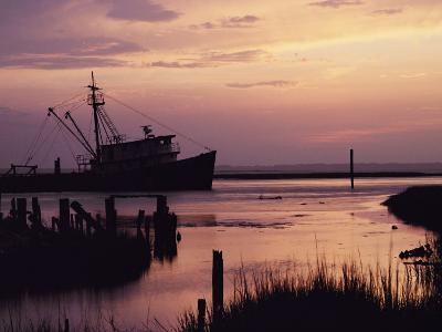 Fishing Boat Silhouetted at Twilight
