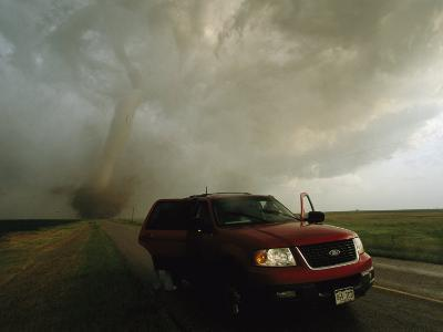 A Massive F4 Category Tornado Rampages Towards a Storm Chasers Van