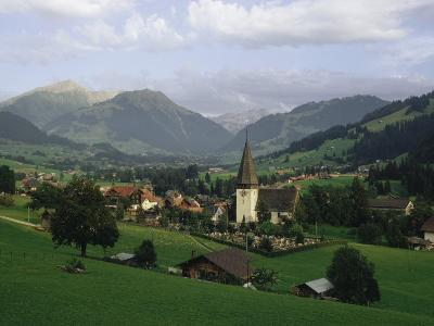 A Pastoral View of a Village in the Swiss Alps