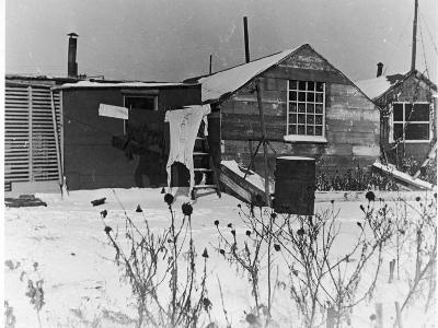 Ex Soldier's Shanty Town in Winter with Laundry Hanging on Line and Snow