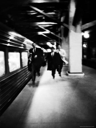Commuters on New York New Haven Line Running to Catch Train Pulling Out of Grand Central Station
