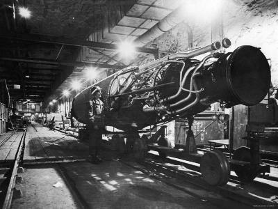American Soldier Examining a V2 Rocket under Construction in an Underground Assembly Plant
