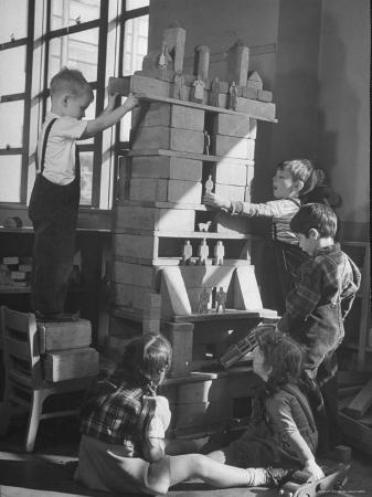 Children Building an Apartment House with Blocks