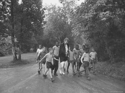 Former First Lady Eleanor Roosevelt Walking on Rustic Road with Children, En Route to Picnic