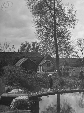 Little Boy Crossing the Bridge over the Stream at Winson Mill Farm, A War Nursery