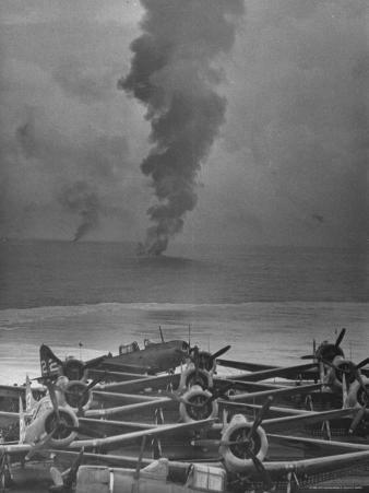 View from Rear Deck of US Aircraft Carrier, Smoke of Burning Japanese Planes Shot Down by Americans