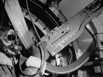 """Waist Gunner Robert G. Nichols Manning His 50 Cal. Machine Gun in the American B-17 """"Little Bill"""""""