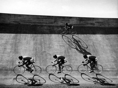 Bicycles Forming Distorted Designs on Track as Peddlers Grind Away in the 4,000 Meter Team Pursuit