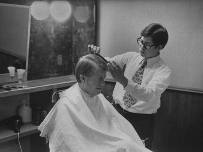 Gov. Jimmy Carte Receiving a Hair Cut
