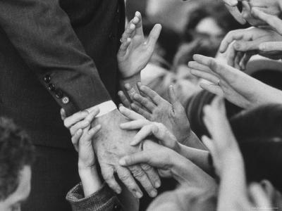 Senator Robert F. Kennedy Shaking Hands with Admirers During Campaigning