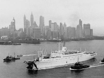 Aerial View of MS Stockholm Entering Harbor After Crash with SS Andrea Doria Against Skyline
