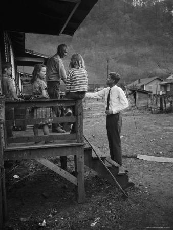 Senator John F. Kennedy Greeting Rural Family While Campaigning For President