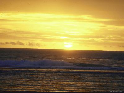 Sunset over Indian Ocean Viewed from Beach of Cocos Islands