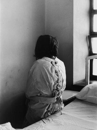 Patient in Mental Hospital Wearing a Restraining Garment