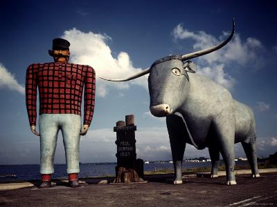 Painted Concrete Sculpture of Paul Bunyon and His Blue Ox, Babe Standing on Shores of Lake Bemidji