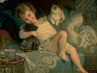 Young Girl Playing with Puppy and Kitten While Lying on Bed