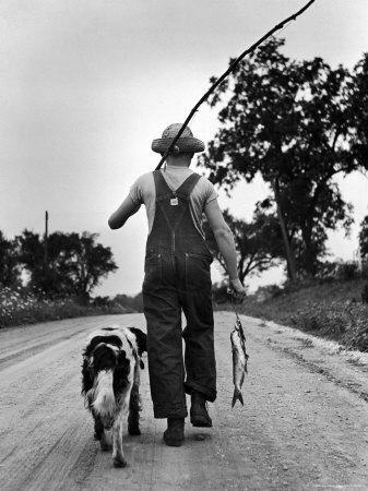 Young Boy and His Dog Walking Home from Fishing