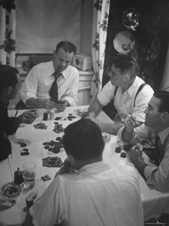 Men Playing Poker at Dining Room Table Covered with Chips, Cards, Ashtrays and Glasses