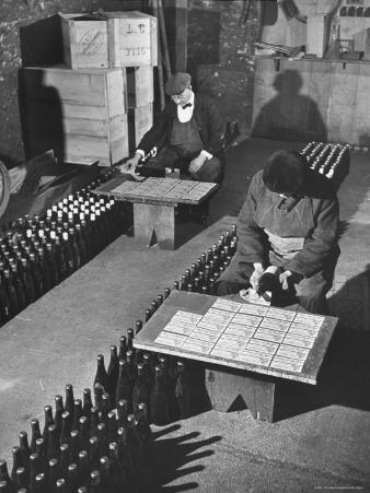 Men Putting Labels on Wine Bottles