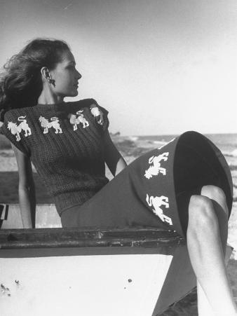 Model Wearing Sweater and Skirt Decorated with Roaring Lions