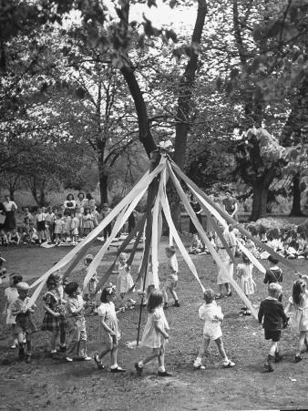 School Children Playing Around the May Pole