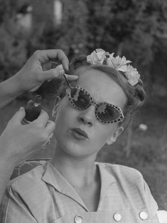 Teenage Girl Having Nail Polish Touches Added to Her Sunglasses