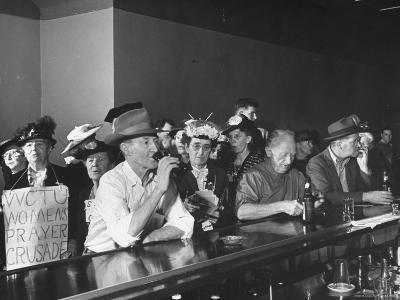 Women's Christian Temperance Union Members Invading Bar While Customers Remain Indifferent
