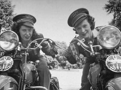 Woman and Her Daughter Sharing Interest in Motorcycle Racing