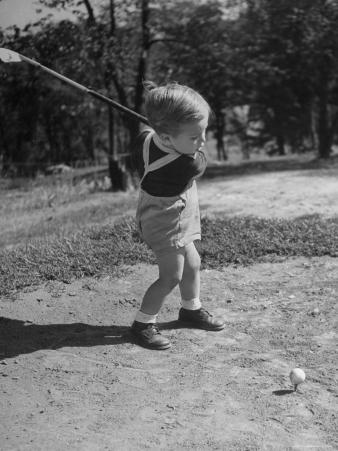 Two Year Old Golfer Bobby Mallick Taking a Swing