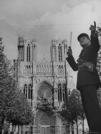 Policeman Directing Traffic in Front of the Reims Cathedral