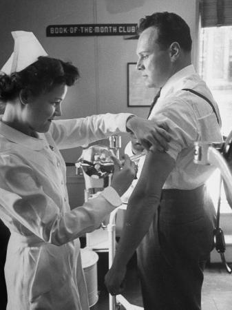 Nurse Taking a Blood from a Patient