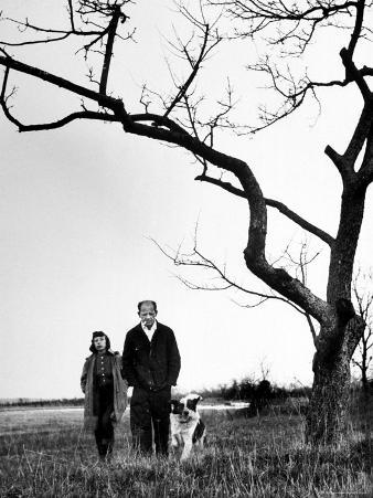 Painter Jackson Pollock Walking in Field with Wife Lee Krasner