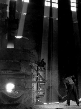Worker Shoveling Limestone Into an Electric Blast Furnace at Republic Steel Mill