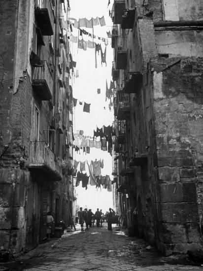 Slum Street With Laundry Hanging Between Buildings