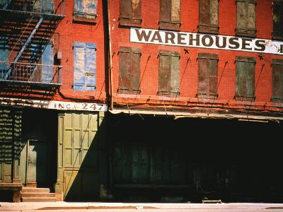 Shuttered Warehouse on the Lower East Side Lit by Late Day Sunlight