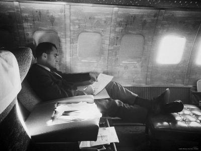 Richard M. Nixon Working on Board Plane