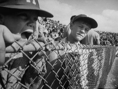 Young Fans Standing at Fence Which Borders Field at World Series Game, Braves vs. Yankees