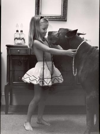 Model Posed Putting Costume Jewelry on Great Dane, Children's Fall Fashion