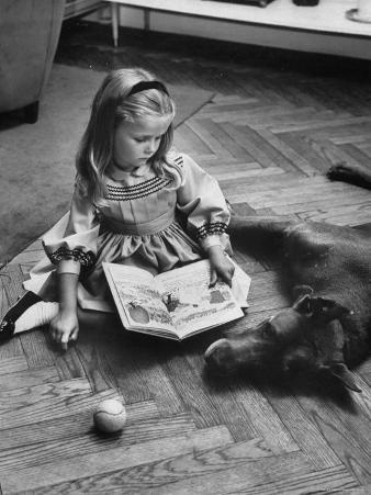 Model Posing with Book and Pet Dog