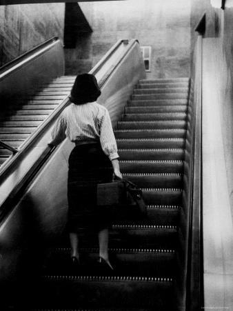 Woman Riding on Escalator in the Time and Life Building