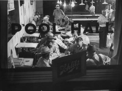 Scene from a Small Town Pool Hall, with People Just Hanging Out and Relaxing