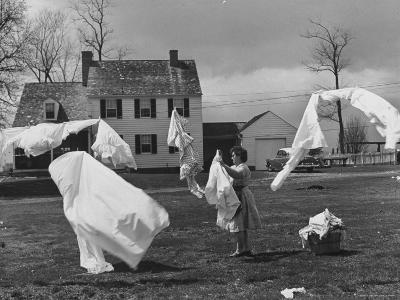 Woman Hanging Up the Laundry on the Line