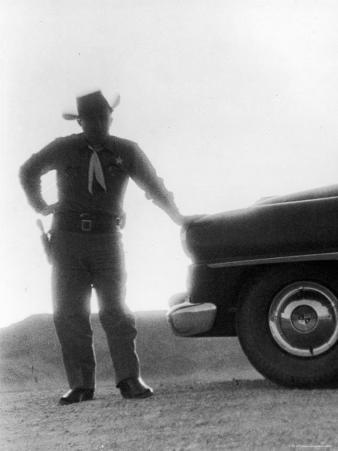 Nevada Sheriff Standing Against the Light from an Atomic Blast 40 Miles Away