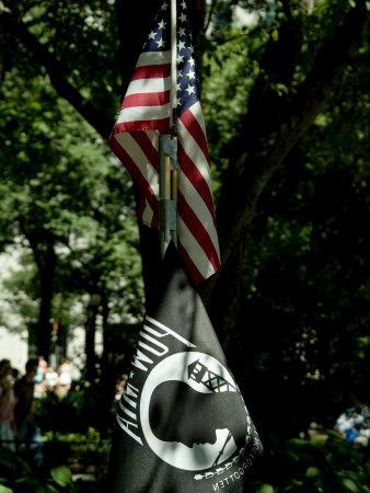 American Flag Hanging Above a Pow-Mia Flag in a Park in New York