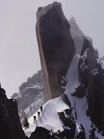 Climbers Move Carefully Across Steep Mountain Slopes