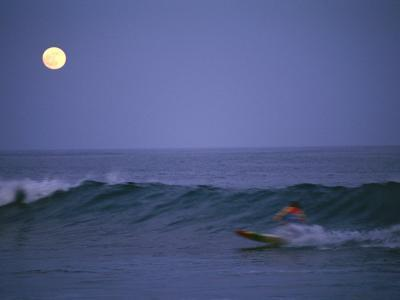 A Man Surfs on the Pacific Ocean in Baja, Mexico